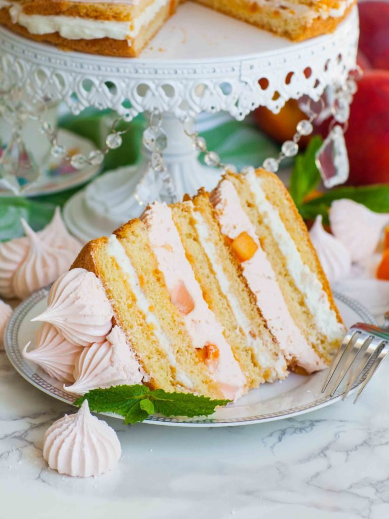 sliced fluffy peaches and cream cake recipe with marshmallow layers