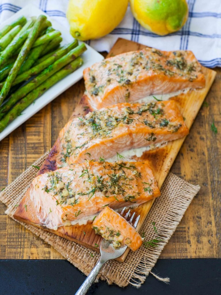 lemon herb salmon recipe on cedar plank with asparagus