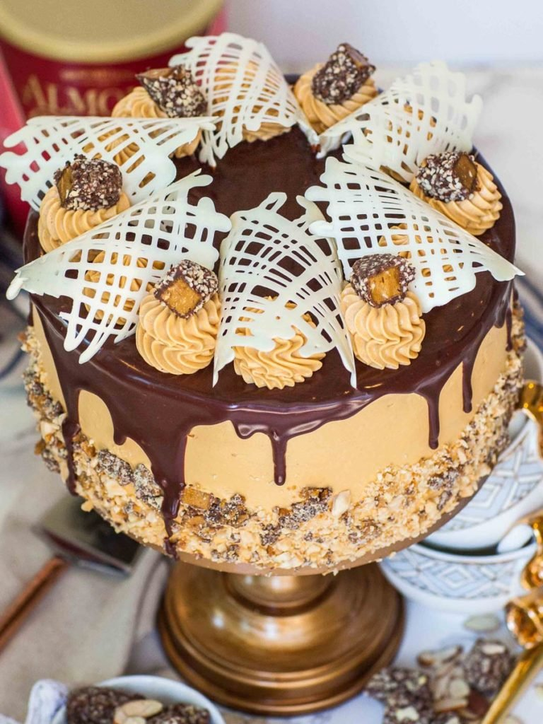 caramel cake with chocolate ganache, chocolate lace and almond roca candy