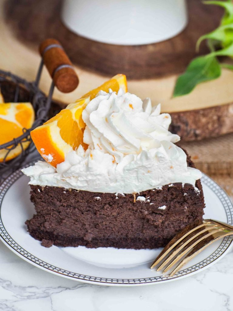 chocolate cheesecake slice with orange zest