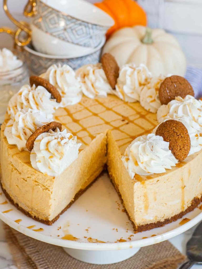 no-bake pumpkin cheesecake with caramel sauce and whipped cream