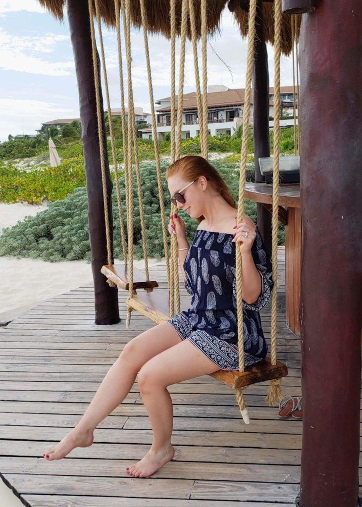 enjoying the bar swing at the beach