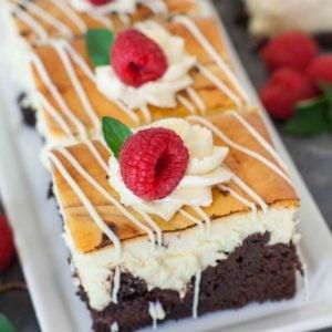 chocolate brownie raspberry cheesecake bars with raspberry