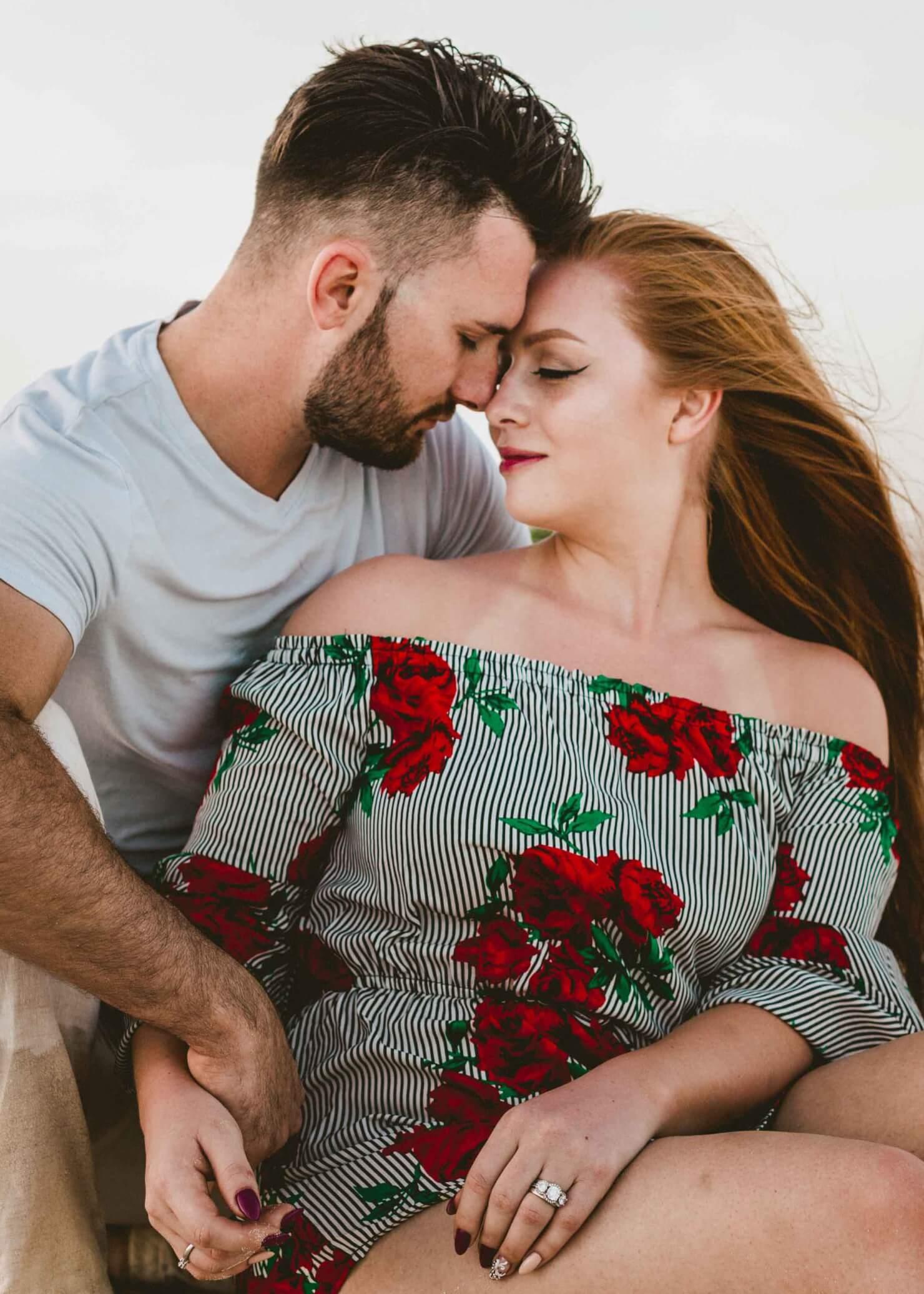 romantic couples photoshoot on the beach