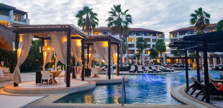 pool cabanas in the evening at Secrets Playa Mujeres