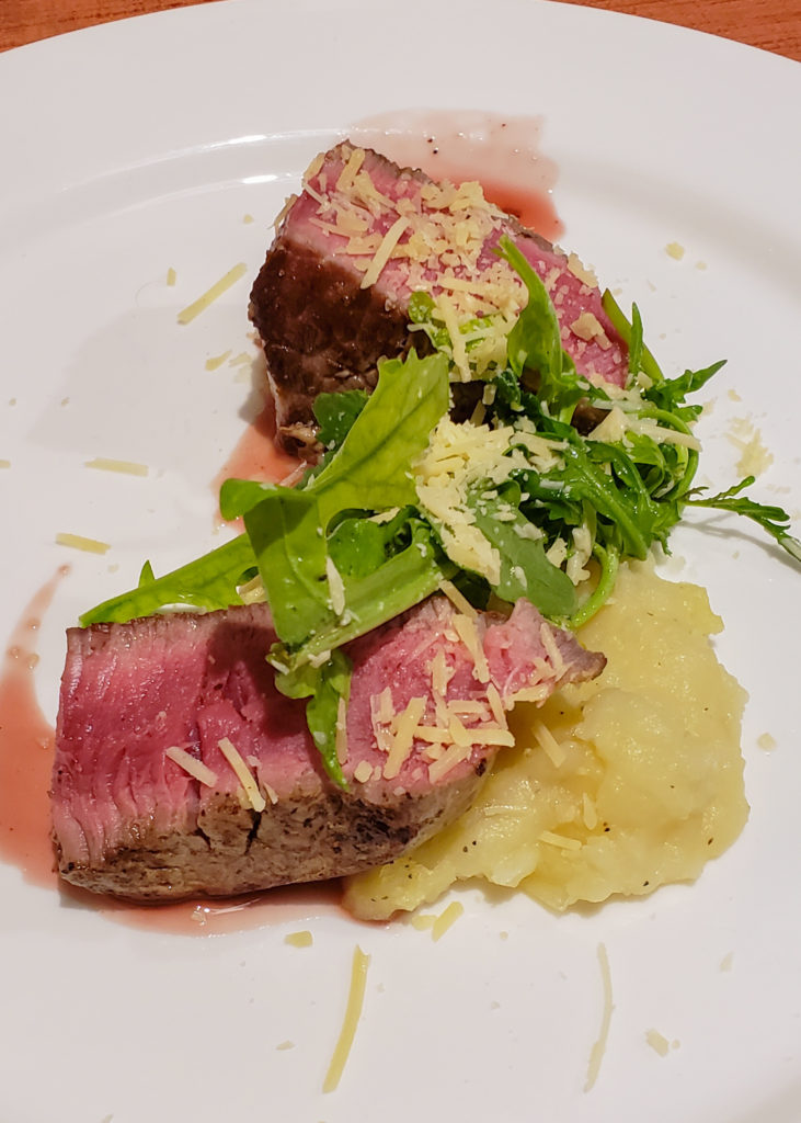 Filet mignon steak with puree and greens