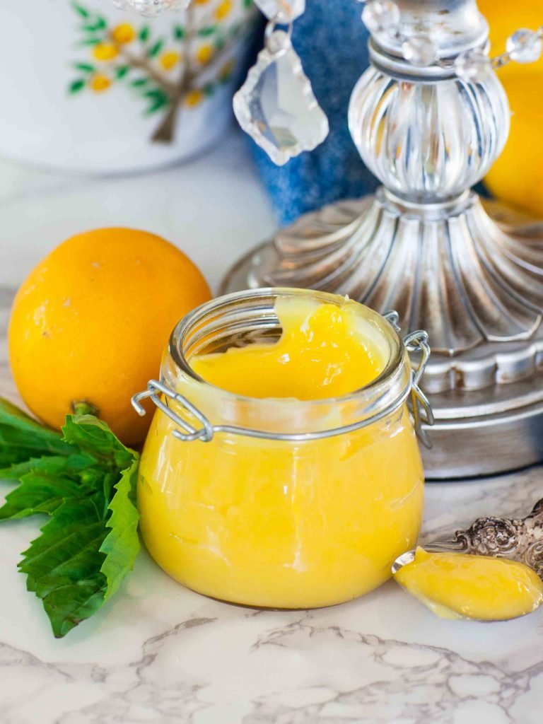 small jar of home-made lemon curd with meyer lemons