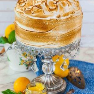 lemon meringue cake on rhinestone stand with torched meringue