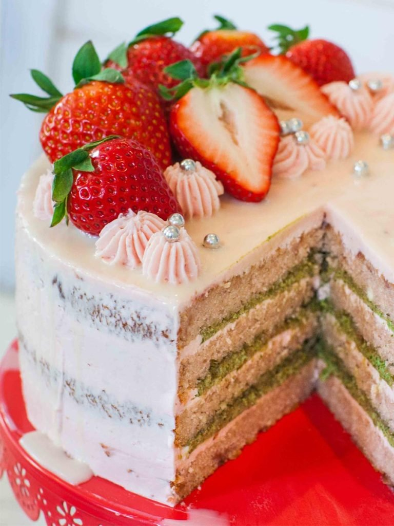 beautiful strawberry basil cake sliced open with strawberries