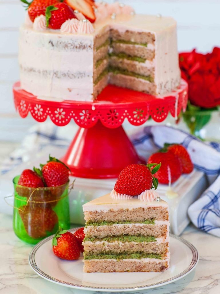 strawberry basil cake sliced open with cake slice on a plate