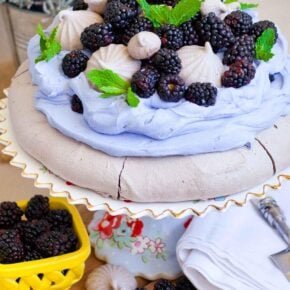 chocolate pavlova with lavender whipped cream and blackberries