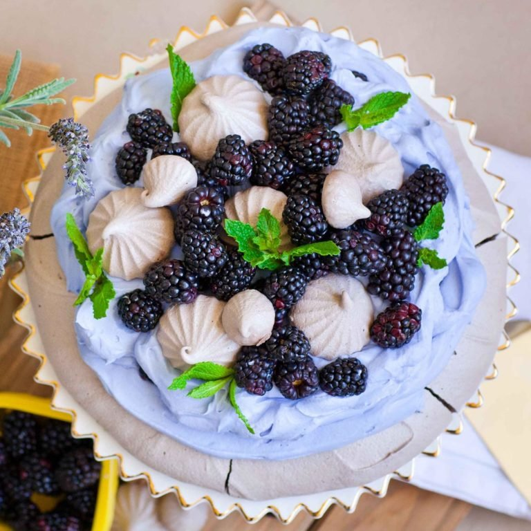 lavender whipped cream with blackberries over chocolate meringue