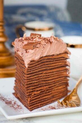 triple chocolate crepe cake slice on plate