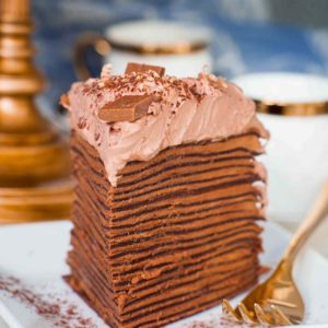 triple chocolate crepe cake slice on plate