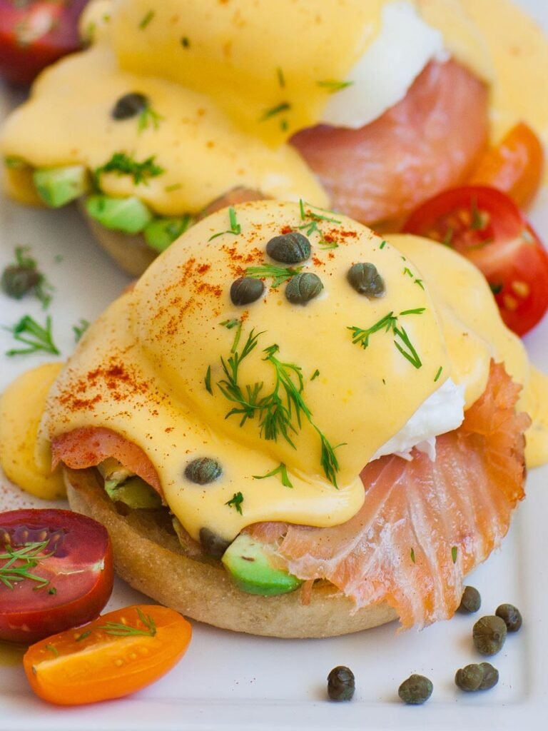eggs benedict with avocado, tomatoes, smoked salmon and homemade hollandaise sauce