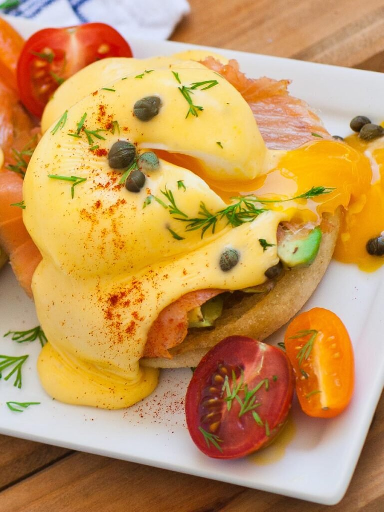 smoked salmon eggs benedict with tomatoes, capers and dill