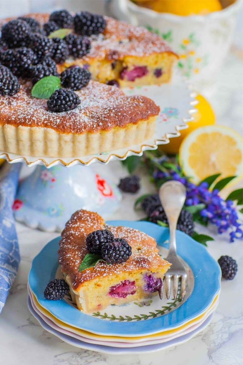blackberry lemon frangipane tart slice on plate