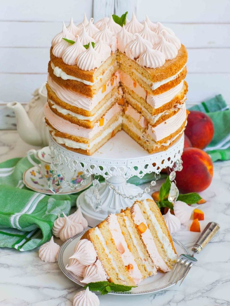 sliced peaches and cream cake with real peaches and peach zefir