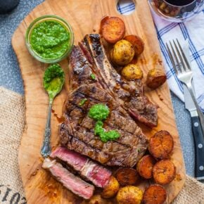 grilled ribeye steak with baby potatoes and chimichurri sauce