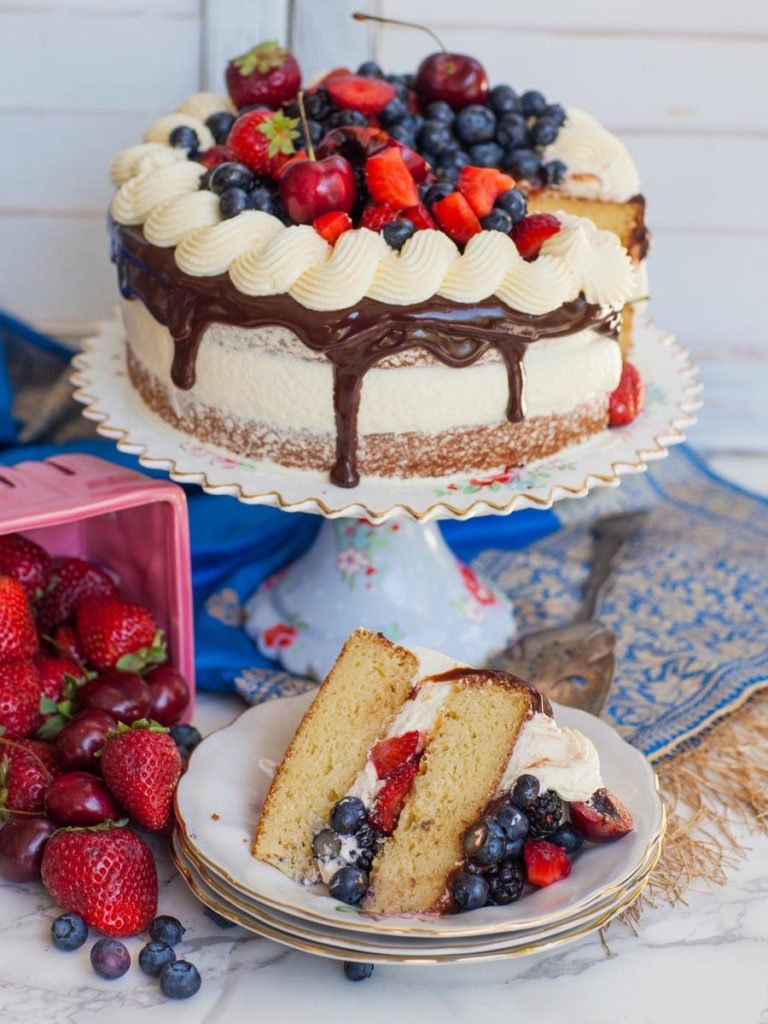 almond cake slice with berries and almond buttercream