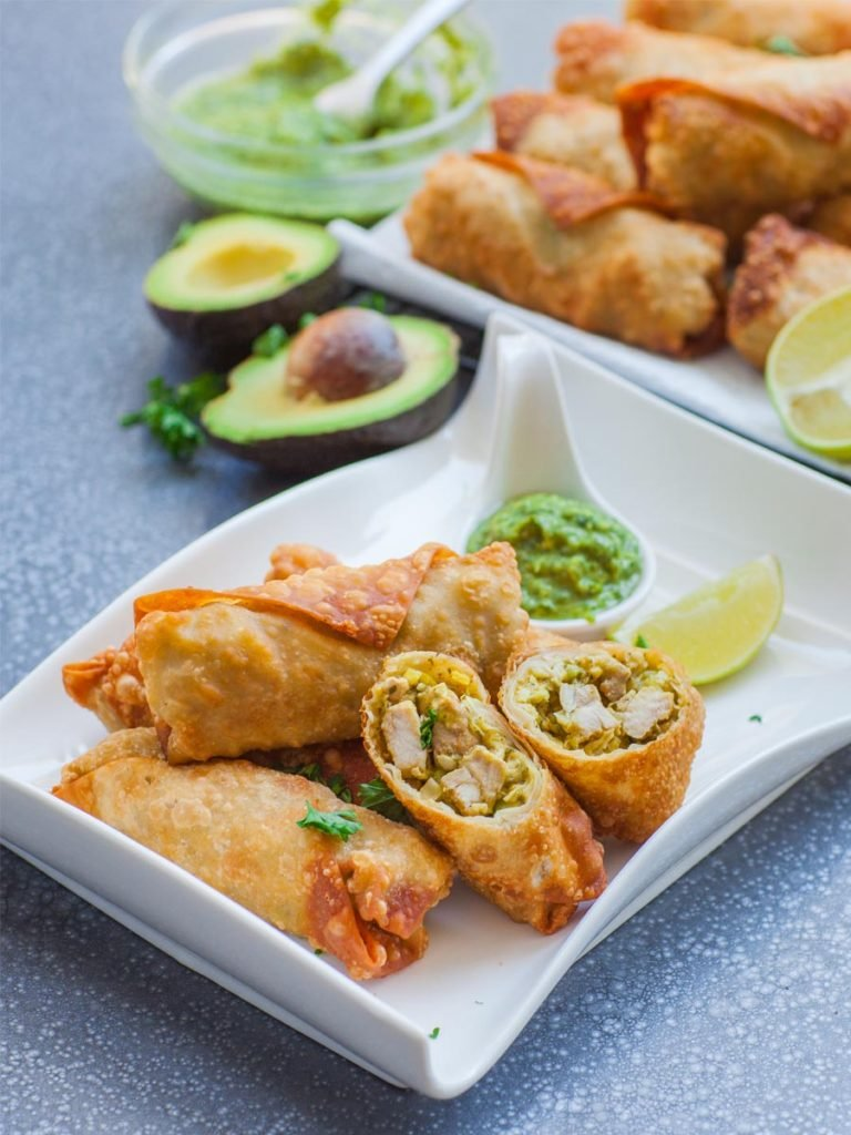 avocado chicken egg rolls with chimichurri sauce and lime wedge