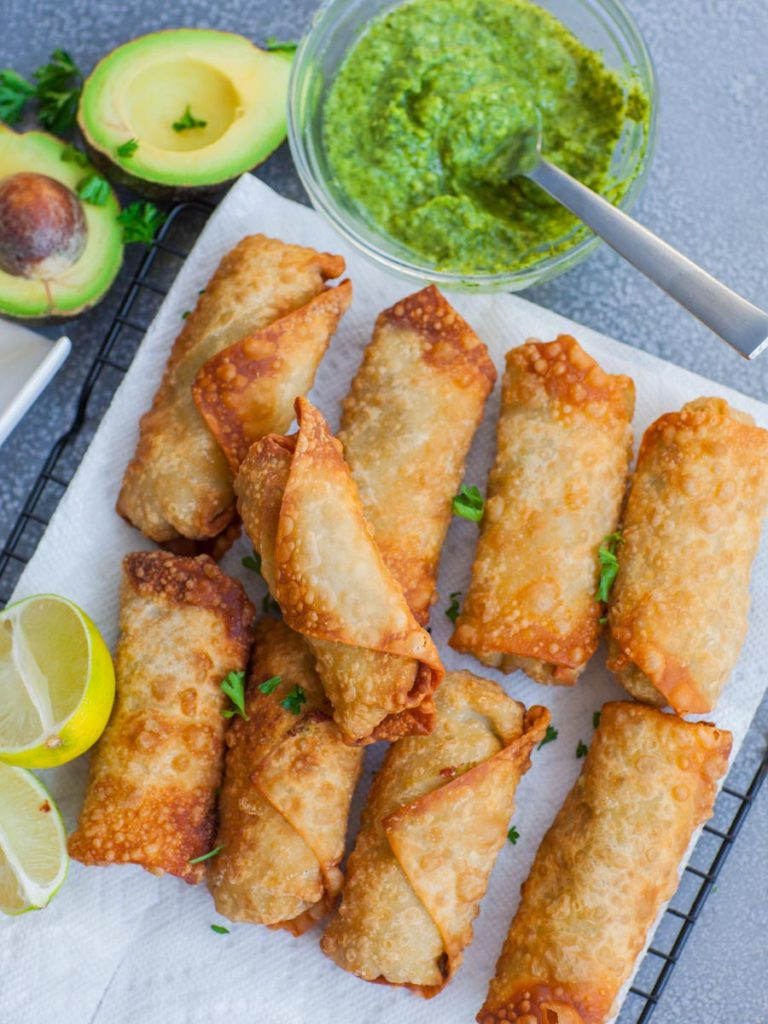 crispy golden egg rolls with avocado and chimichurri sauce