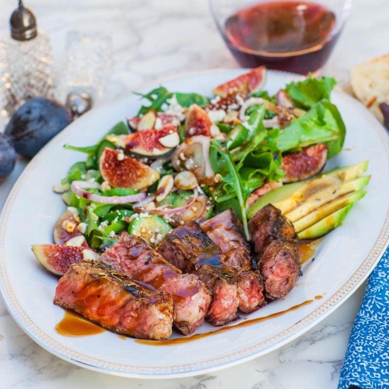 ribeye steak salad with steak sauce, greens and figs