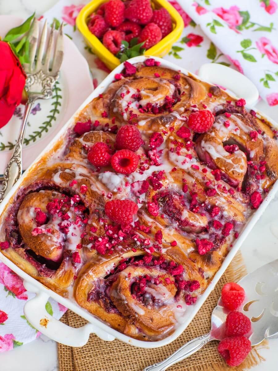 large raspberry rolls in white casserole dish