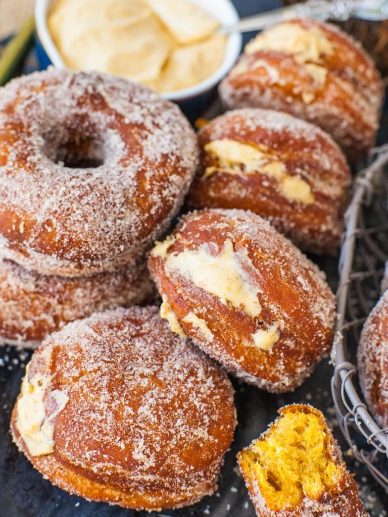 filled pumpkin donuts with pumpkin whipped cream filling