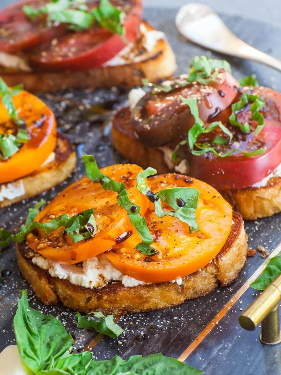 yellow heirloom tomato on toasted sourdough bread, tomato toast
