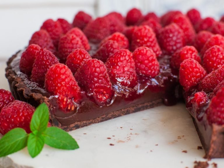 inside of chocolate raspberry tart with fresh raspberries