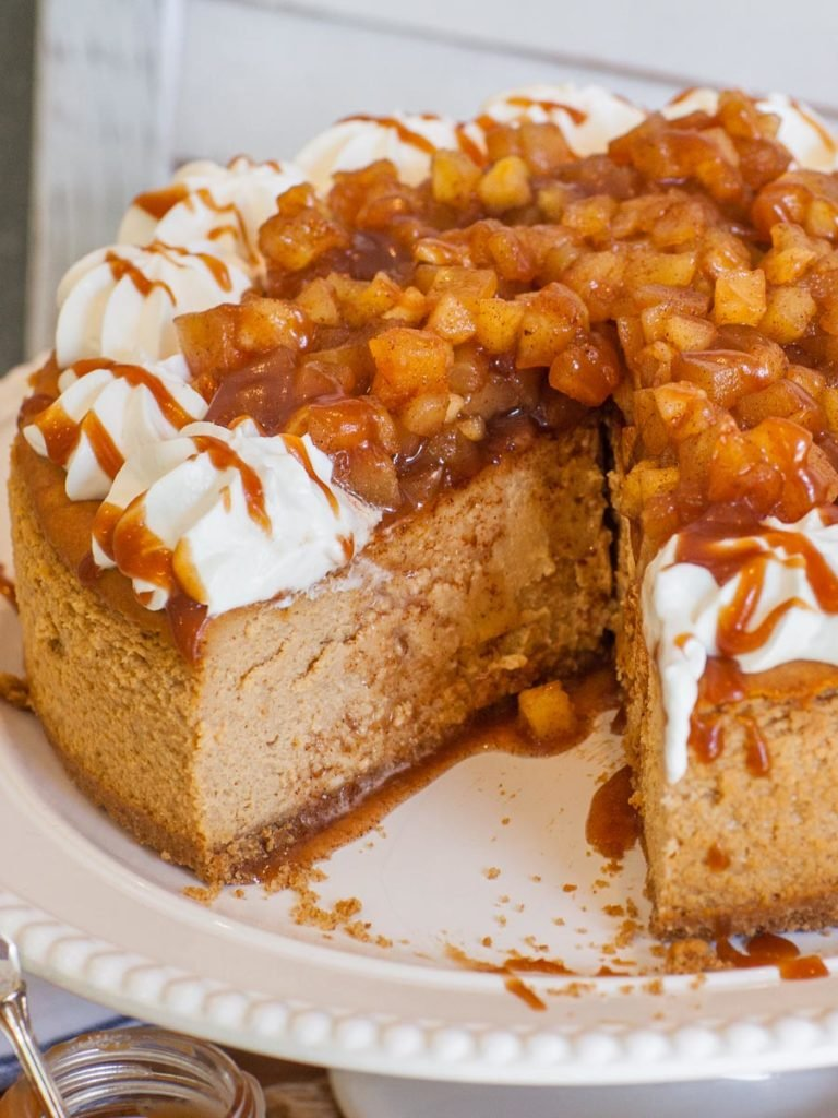 apple pie cheesecake with caramel and whipped cream for Thanksgiving