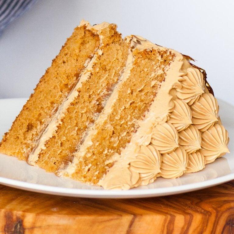 slice of caramel cake with salted caramel frosting