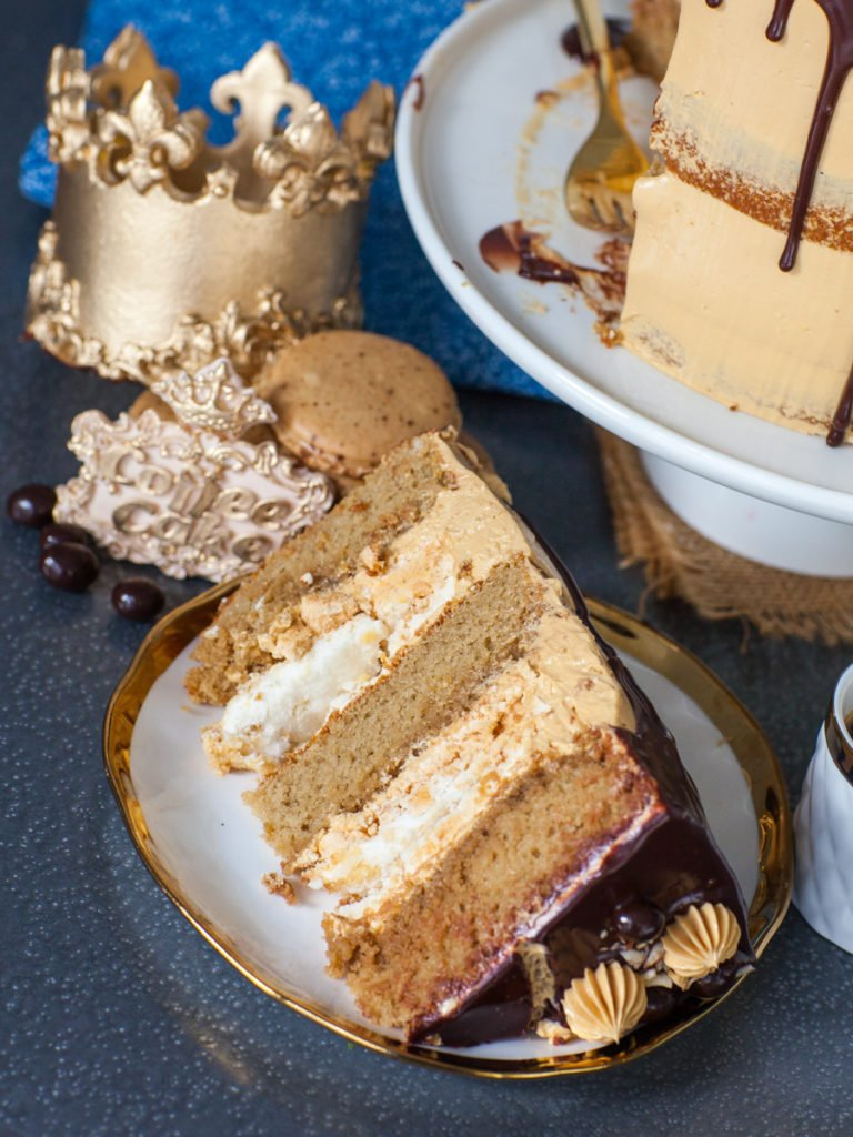 coffee cake slice on gold plate with hazelnut meringue