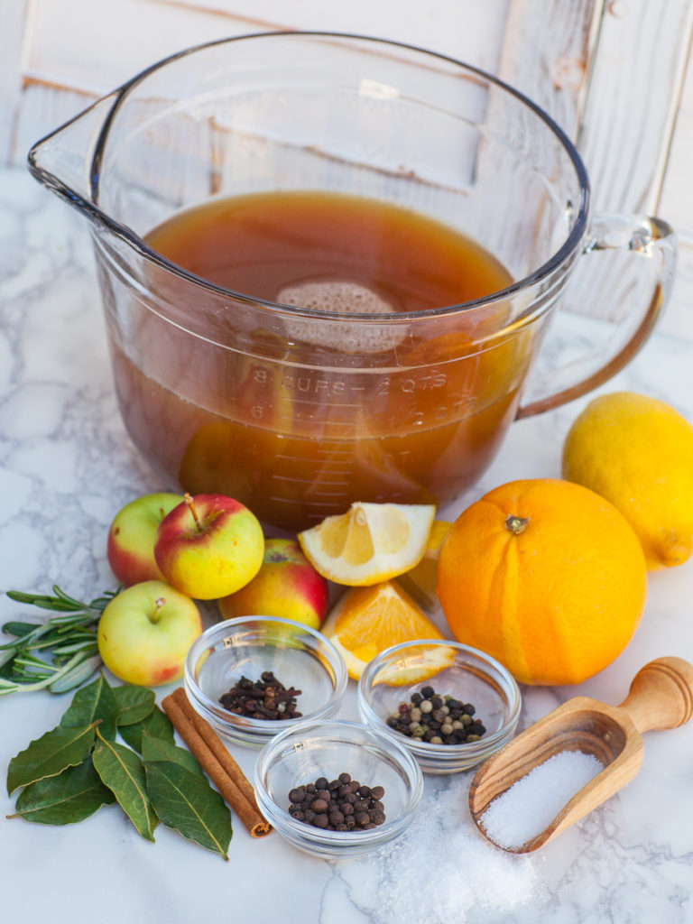 apple cider with spices, apples and citrus for turkey brine