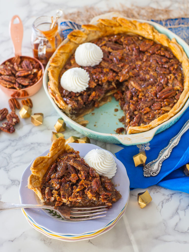 pecan pie with whipped cream and maple syrup