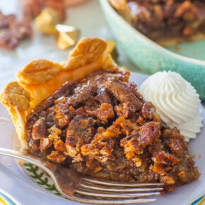 slice of classic pecan pie with whipped cream