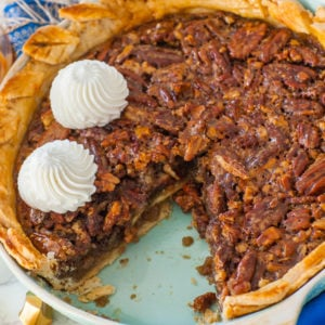 classic pecan pie recipe with no corn syrup; topped with whipped cream