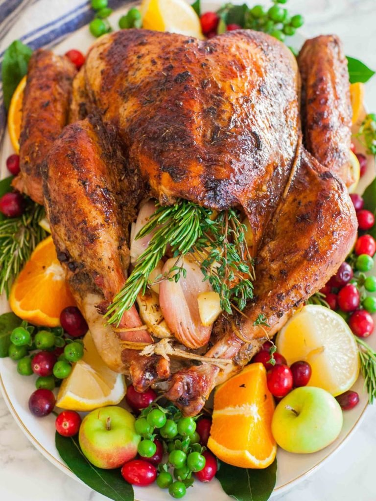 garlic butter turkey on a serving platter for Thanksgiving