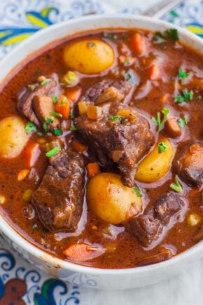 beef stew with slow braised beef, potatoes, carrots and parsley