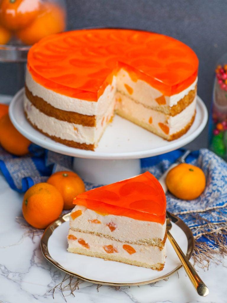 mandarin mousse cake slice with jelllo topping and fresh mandarins