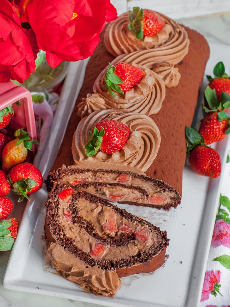 chocolate sponge cake roll with nutella whipped cream and strawberries; strawberry roulade