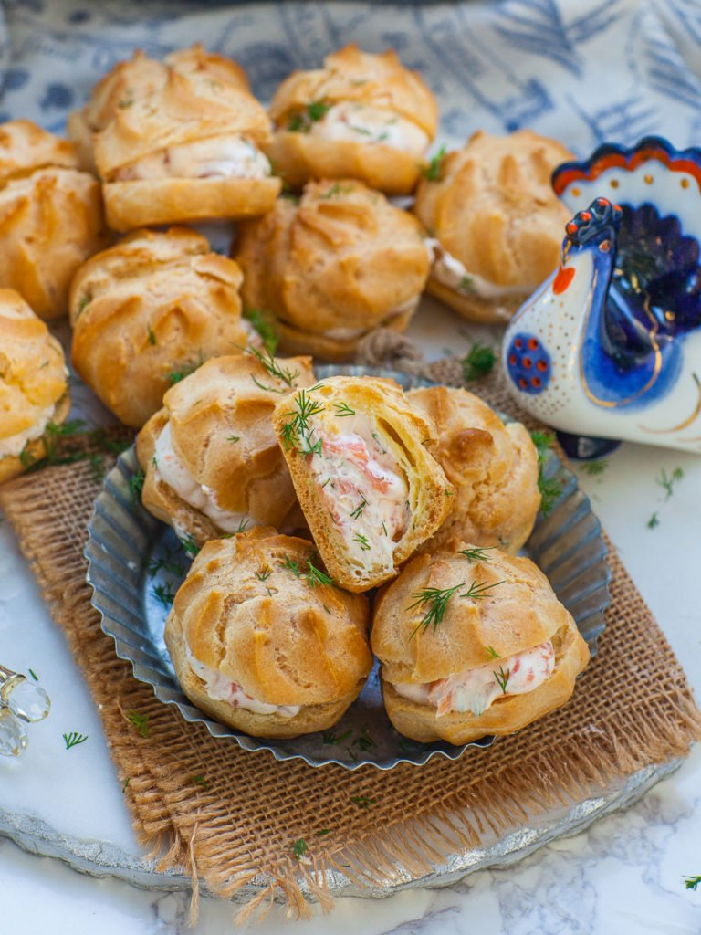 smoked salmon profiteroles with dill and cream cheese; seafood appetizer; salmon puffs