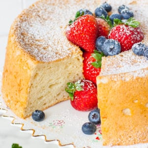 angel food cake with berries and confectioner's sugar