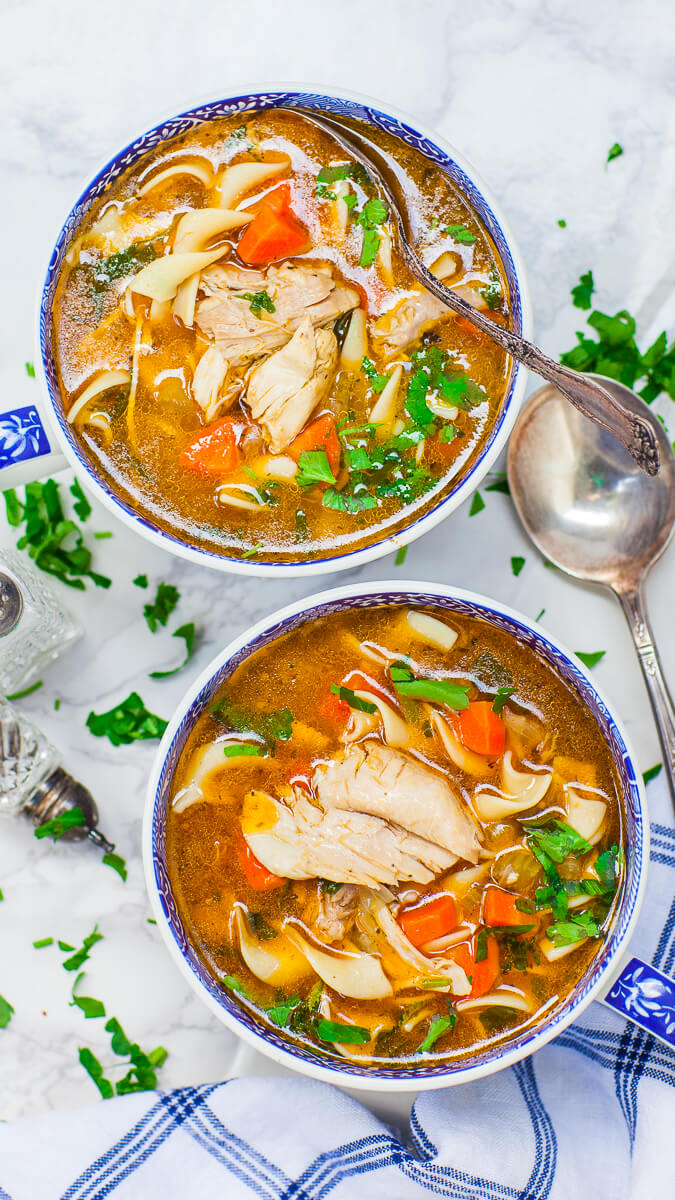 the best chicken noodle soup with parsley and carrots; made with bone-in chicken
