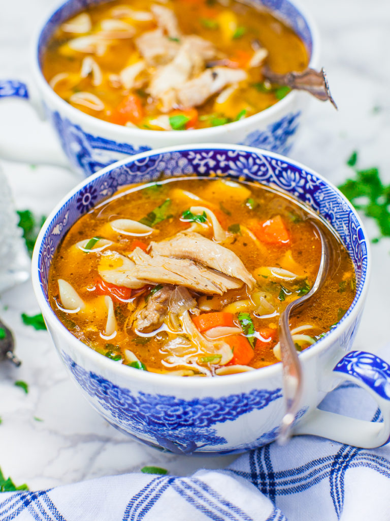 hearty and warming chicken soup recipe with noodles and carrots