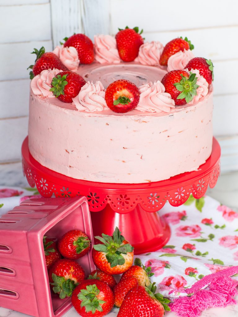 keto cake with strawberry keto buttercream and keto chocolate sponge cake and fresh strawberries