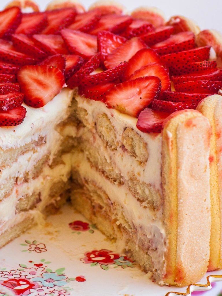 inside of strawberry tiramisu cake with lady fingers and custard