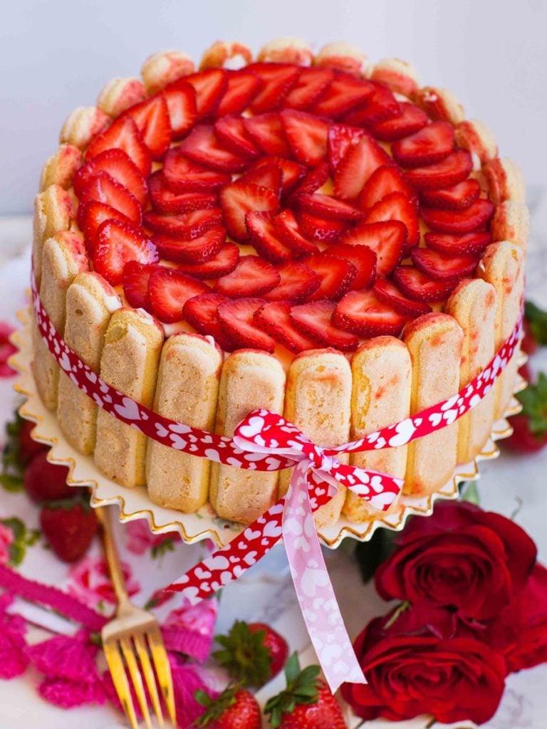 no bake strawberry tiramisu cake with strawberry garnish