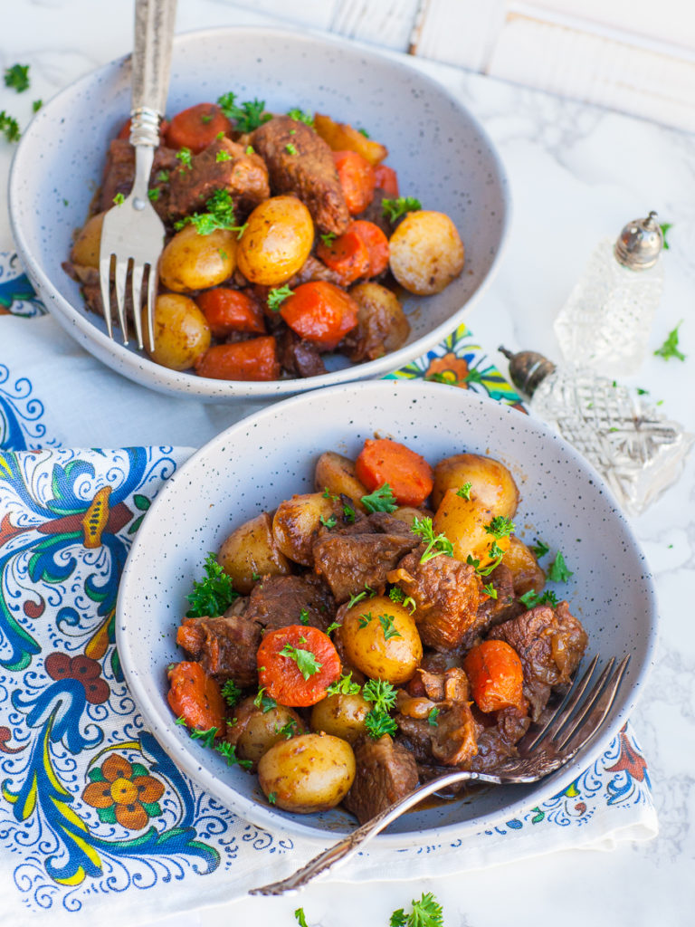 roast lamb dinner with carrots and potatoes